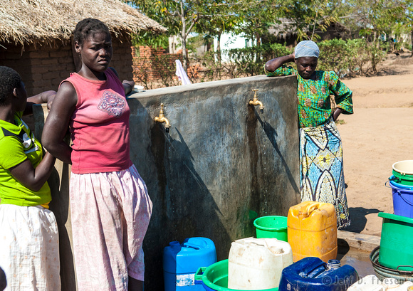 Women wait for water