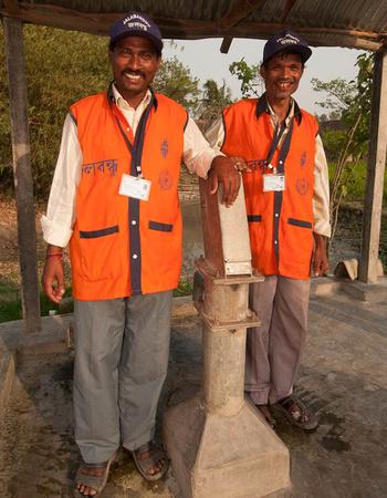 Jalabandhus stand beside an India Mark II pump